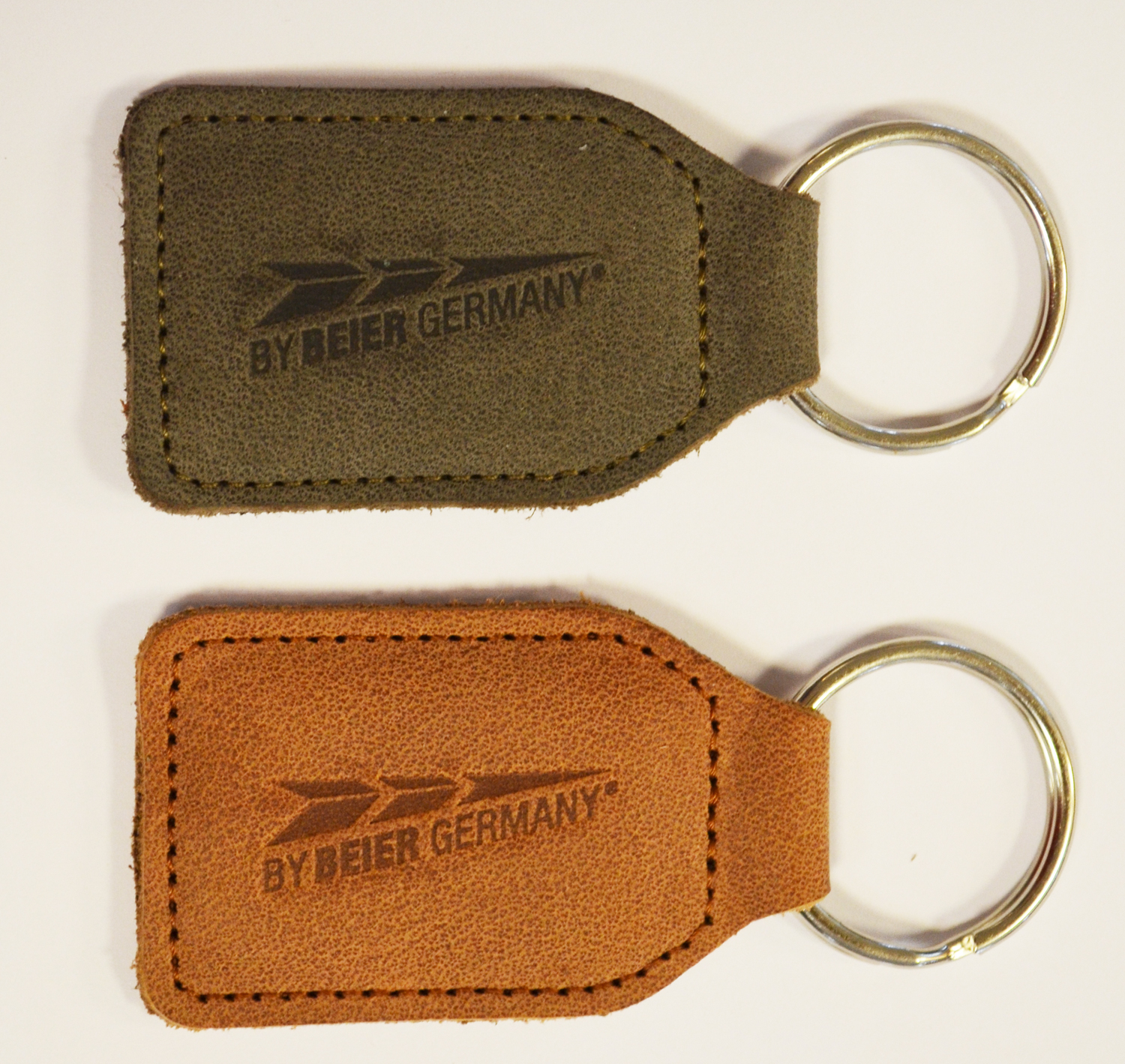 Key fob cambered, 60x40 mm, natural calf leather, stamping, key ring
